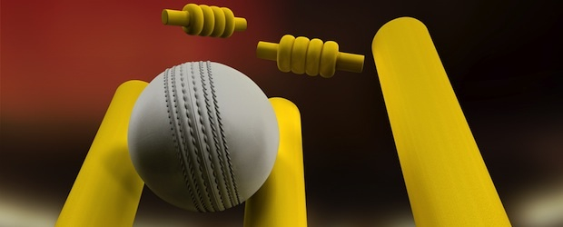 indoor cricket: white cricket ball hits yellow stumps