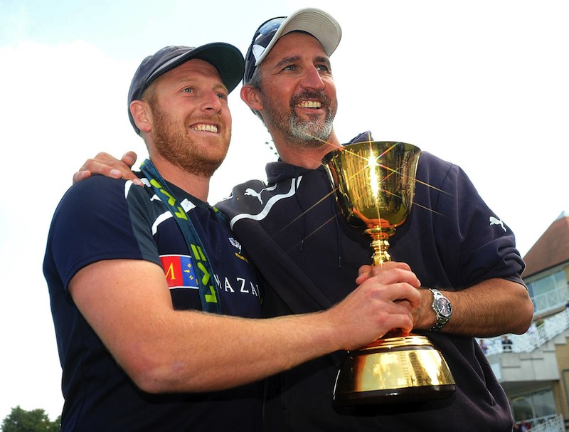 jason gillespie and andrew gale hold the championship trophy