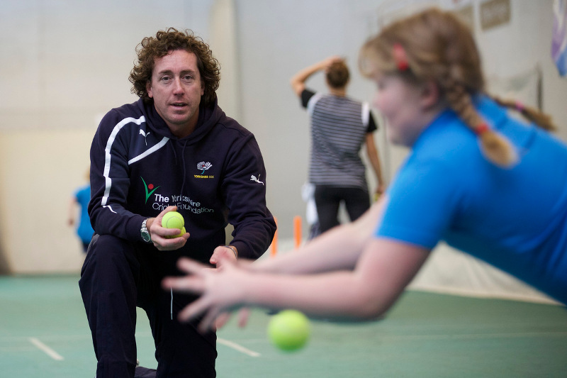 girl does catching practice with Ryan Sidebottom