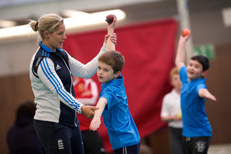 Katherine Brunt offers bowling coaching to a junior cricketer as part of the Drax Cup