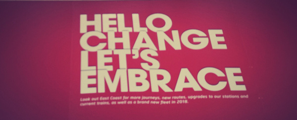 Hello Change let's embrace sign at leeds railway station
