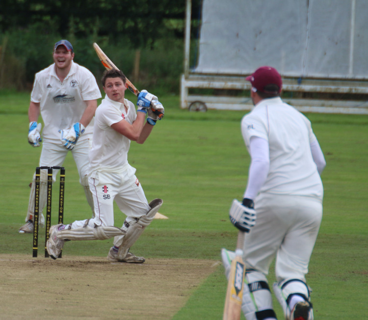 batsman hits to mid-off watched by the wicketkeeper