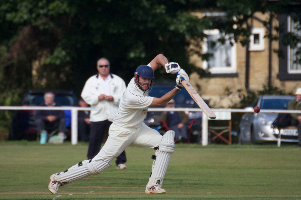 Club cricket - cricketer drives the ball