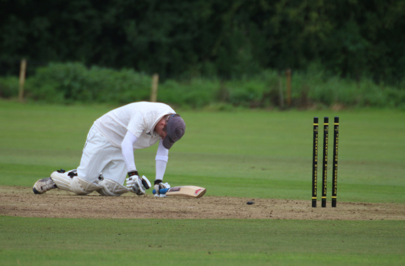 a batsman on his knees after a runout