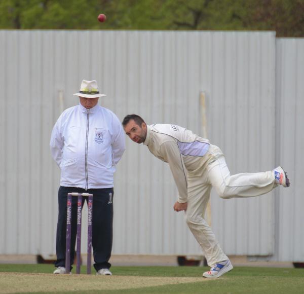 Dan Woods of York Cricket Club bowls