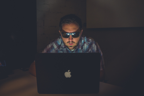 stereotype of a forum user as a bloke in the dark on his laptop