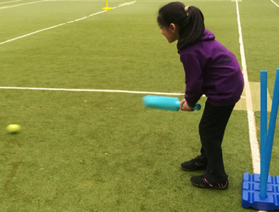 a girl bats at Keighley BME Development Centre