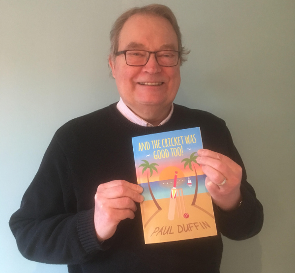 author paul duffin holds up his copy of his cricket book - and the cricket was good too!