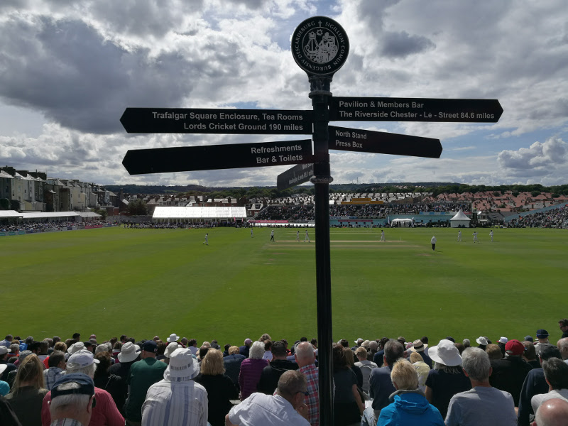 scarborough cricket club pitch view from the entrance with the famous black signpost
