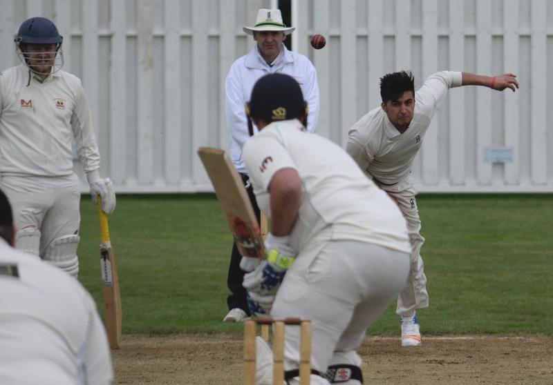 Imran Khan bowls for Houghton main