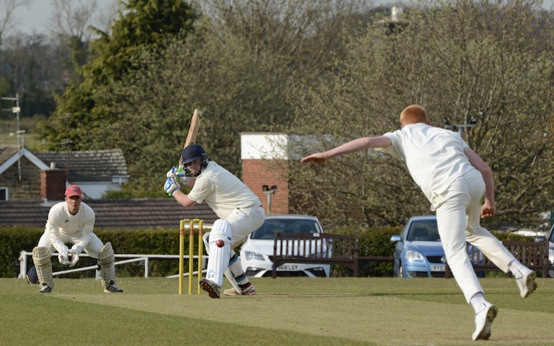 leeds and wetherby cricket league action as a batsman gets ready to drive a ball.